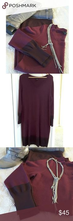 Burgundy Sweater Dress with Maroon Border This super soft wool blend sweater dress has the softness of cashmere and is on trend with the 2016/17 fall/winter color palette. The dress is a deep wine color with bands of deeper maroon at the cuffs and the bottom of the dress. Cozy, comfy and classic this dress is ready for the office and after. NWOT Ann Taylor Dresses Midi