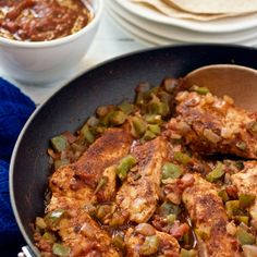 Skillet Salsa Chicken - Skillet salsa chicken is an easy, fast, healthy dinner that's packed with flavor! It's great over brown rice or in a whole wheat wrap.