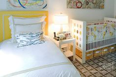 Like the combination of patterns in this nursery and the single bed headboard