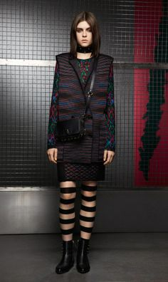 CYBER VEST & STRETCH SKIRT The sleeveless double-breasted jacket gives a highly original and sophisticated touch to your look, here combined with a mesh Ikat print viscose stretch flare and a skirt, cleverly built over a mesh background. The trump card is the engaging mix of colors and shades.