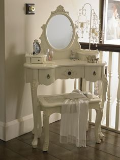 Dressing table and mirror shabby french style vintage chic paris bedroom.