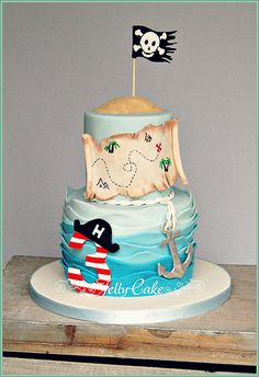 "This is the cake for my gorgeous Nephew's Birthday. He had a pirate themed party, so a pirate cake it had to be! A wavy sea with a sugar ""Pirate"" no. sugar anchor and pirate map with the skull and crossbones flag blowing in the wind! Fancy Cakes, Cute Cakes, Pirate Birthday Cake, Pirate Cakes, 3rd Birthday, Birthday Cakes, Birthday Ideas, Easter Bunny Cake, Cakes For Boys"
