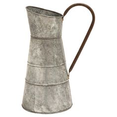 Metal watering jug with an antiqued silver finish.    Product: Watering jugConstruction Material: Metal