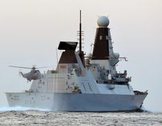 A Royal Navy Sea King helicopter lands on Type 45 destroyer HMS Diamond.