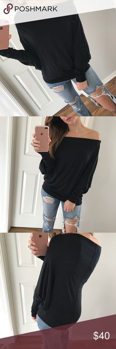 """Black Off The Shoulder Dolman Excuse my mirror 🙈 This is such an amazing basic. Has an incredible texture, very easy to place where you'd like it to lay, dolman body and the fabric has the same amount of stretch all over. Sleeves and back seam have cute stitching as well. Non-sheer. So easy to throw on with any style bottoms and go! Also in olive   Modeling: S Measures: 24"""" L • chest is open  Size Difference: .5-1"""" all over Fabric: Modal & spandex   Please use the """"Self Checkout or """"Add To…"""