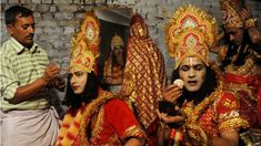 Indian artists dressed as Hindu Lord Rama (2nd L), Sita (C), and Laxman (2nd R) put on their make-up before performing the Ramlila ahead of Dussehra in Amritsar