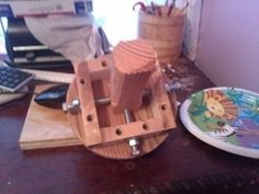 Four Jaw Chuck - Homemade 4-jaw chuck constructed from wood, bolts, nuts, and washers.