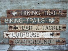 Rustic Distressed Hiking Trails, Biking Trails, Outhouse, Campground, Bait and Tackle Wood Lodge Sign Set Stock