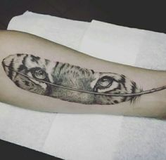 Tiger feather tattoo, i really like this tattoo but i may replace it with a wolf or different animal