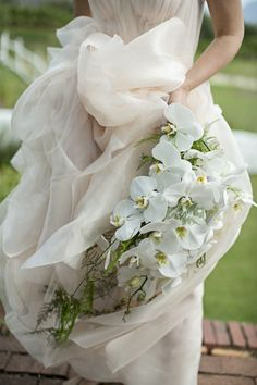 white orchid bouquet | Botanical Romance Eben Haezer Wedding by Lizelle Lotter {Jeanne Neal} | SouthBound Bride #wedding #bouquet