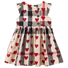 Beige New Classic Check and Heart Print Dress $226 From  Burberry comes this fresh take on a classic item. This nova check dress is decorated with prints of bright red hearts all-over, with button fastenings to the front and frills adorning the arm holes. Pair with simple crib shoes for a party-ready look your little one is sure to feel special in.