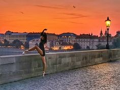 Ballerina on the Charles bridge in the early morning, Prague, Czechia