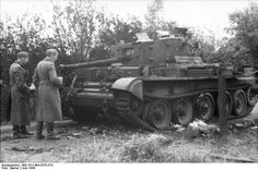 Normandy 1944 Nazi troops inspect a knocked out British Cromwell ...