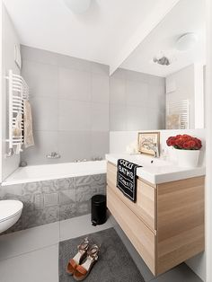 gray tile in bathroom design by LOFTSTUDIO/ szare płytki w projekcie LOFTSTUDIO  Możemy wykonać dla Ciebie taki projekt: zapraszamy na www.loftstudio.pl