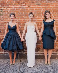 These navy blue wedding dresses match each other in shade, but complement each bridesmaid.