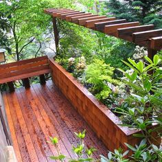Second story deck with small pergola and flower box