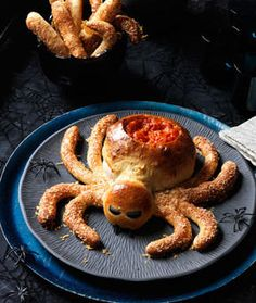 Love this!! Spider Bread Loaf with carved out dip bowl and Hairy Legs Breadsticks - uses frozen pizza dough. Woman's Day