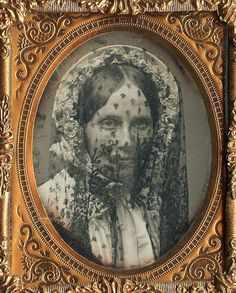 Bonnet & veil. It's great to see one of these worn. Interesting how the spotted part is easier to see through, and the patterned part disguises the face much more. (Image is from the 1850s.)