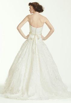 Beaded Lace Wedding Gown Showcasing A Strapless Sweetheart Neckline, Dropped Waist, Ball Gown Skirt With Court Length Train by Oleg Cassini for David's Bridal