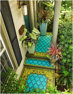 Wow. This is a stencil painted PAINTED porch. I love the bold colors.