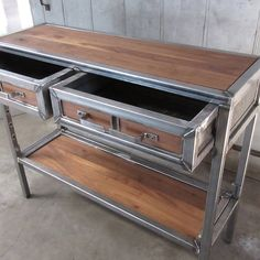 """A beautiful handmade piece with steel tubing and reclaimed walnut. This table is built to last. This table is built out of 1-1/2"""" steel tubing and reclaimed walnut. The walnut shelf adjusts to 3 levels to allow for optimum usage. Please note – the shelf and tops and drawer fronts may vary due"""