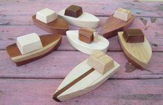 Classic small wooden boats for sophisticated little boys.