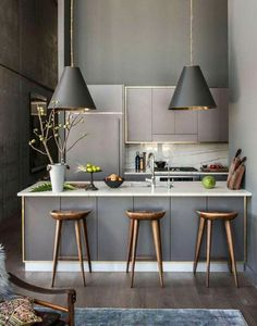 interior design of kitchen room. Small modern kitchen with grey shades and gold accents  18 kitchens that have perfected minimalism Famous interior