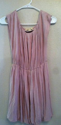 Pretty tunic Maybe/rose colored tunic with elastic waist. Sleeveless with lots of rouching detail. Gently used. Tops Tunics