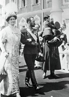 "Tsar Nicholas ll of Russia and Empress Alexandra Feodorovna of Russia with the Tsarevich Alexei Nikolaevich Romanov of Russia diring the Tercentenary Celebrations of the Romanov Dynasty. ""AL"""