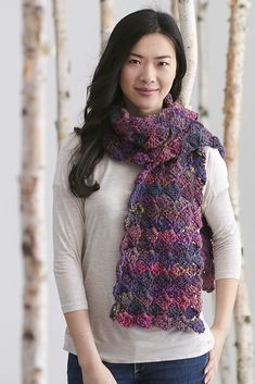Plumtacular Scarf -  Indulge in lavish shades of plum with this plush and cozy scarf. Made of 100% pure wool, this simple project uses self-patterning yarn to achieve a multicolor effect. From the February 2015 issue of I Like Crochet.