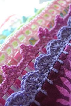 Crochet trims on pillowcase... what a pretty way to add a crafty touch to homewares. We may have to learn crochet now!!!