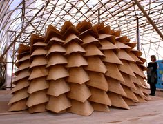 """Dragon Skin is a collaboration between architects Emmi Keskisarja, Pekka Tynkkynen, Kristof Crolla (LEAD) and Sebastien Delagrange (LEAD), is an ongoing project exploring the use of post-formable plywood in digital design and manufacturing."""