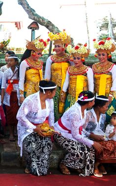 Dress code for religious event: The dress code symbolize the values of Hinduism, which the Balinese have incorporated in...