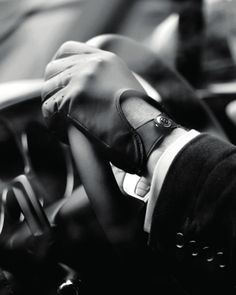 perforated-leather-driving-gloves-and-buttons-on-steering-wheel
