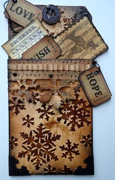 Grungy Snowflake on the Edge Jumbo Tag...with mini tags stuffed in a pocket...Marjie Kemper: Snowflake On the edge die http://marjiekemper.typepad.com/my-blog/2012/12/a-fond-farewell-to-frilly-funkie.html.