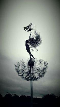 Metal fairy yard art