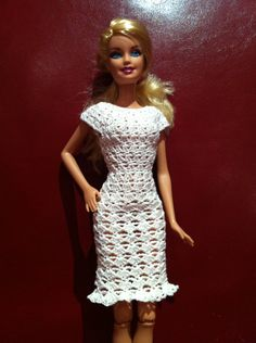Barbie dress I finished last week :-) I'm really pleased with my first attempt. I modified this free pattern: http://members.optusnet.com.au/we2/barbiepicnicdress.html