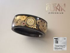 Black Zirconium men's ring with steampunk watch gear inlay and protective resin coating. Steampunk Rings, Steampunk Watch, Steampunk Gears, Watch Gears, Resin Coating, Jaco, Titanium Rings, Black Diamond, Diamond Engagement Rings