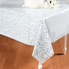 These are inexpensive and could add a lace look to the tables without too much cost.