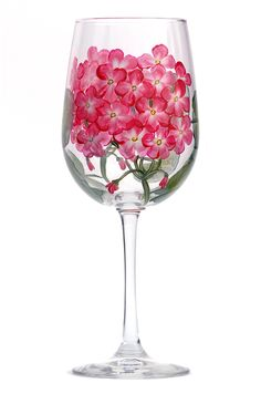 Red and white geranium florets with yellow centers and deep green leaves hand painted on quality 18.5 ounce wine glass