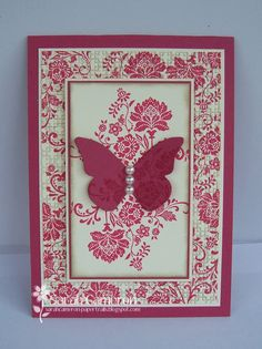 handmade card ... luv wallpaper/fabric look of paper and stamping ... red and white ... everything symetrical ... focal point die cut butterfly on top panel ...  framed with wide border of patterned paper ... luv this card!!