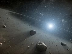 Credit: NASA/JPL-Caltech This artist's concept illustrates an asteroid belt around the bright star Vega. Evidence for this warm ring of debris was found using NASA's Spitzer Space Telescope, and the European Space Agency's Herschel Space Observatory.