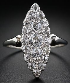 Antique Diamond Navette Ring. Nineteen closely set old European-cut diamonds sparkle mightily from this bright and beautiful navette, or marquise, shape ring measuring just shy of one-inch long by 3/8 inch wide. A dazzler. Lang Antiques.