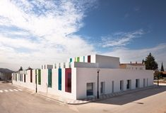 Spanish architect Alejandro Muñoz Miranda designed this kindergarten in Granada, Spain around a central courtyard or playground that serves as the heart of the centre. Colour Architecture, Cultural Architecture, Education Architecture, School Architecture, Modern Architecture, Colourful Buildings, Modern Buildings, Ecole Design, Kindergarten Design
