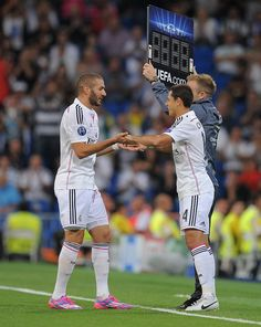 Karim Benzema of Real Madrid is substituted by Javier 'Chicharito' Hernandez during the UEFA Champions League Group B match between Real Madrid CF and FC Basel 1893 on September 16, 2014 in Madrid, Spain.
