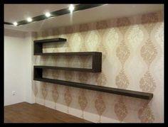 Półki Cellaio doskonale nadające się na ścianę recepcji poczekalni korytarz ale i do salonu czy prywatnego gabinetu Tutaj wersja w kolorze wenge