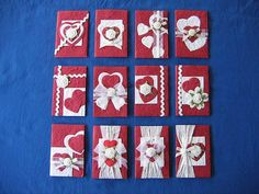set of handmade cards ... red and white ...handmade paper ... hearts ... dimentionsal rolled ribbon roses ... rick-rack ... and wide paper ribbon bands ...