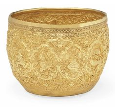 A GOLD-REPOUSSÉ BEGGING BOWL  THAILAND, CIRCA 1900.  Rimless, of slightly rounded profile, on plain base, the gold repoussé decoration with signs of the zodiac within cusped medallions against dense scrolling foliated ground, the base with a kinaree within a roundel 4in. (10.5cm.) diam.