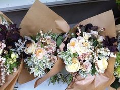 wedding bouquet simple and neutral - maybe with a deep purple/grey flower?
