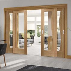 Thruslide Emilia Oak Flush - 4 Sliding Doors and Frame Kit - Stepped Design - Clear Glass - Lifestyle Image. #unique #modern #doors